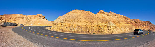 Panoramic view in Arava Desert. Panoramic view on highway among the mountains in Arava Desert, Israel Stock Image