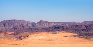 Panoramic view of the Arava valley: the border between Israel to the west and Jordan to the east and Wadi Rum drainage area. With the colorful red sands, cliffs stock photography