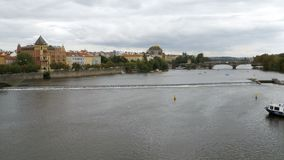 Panoramic view of the architectural buildings and Bridges of Prague near the River Vltava. CZECH REPUBLIC, PRAGUE, SEPTEMBER 12, 2017: Panoramic view of the stock footage