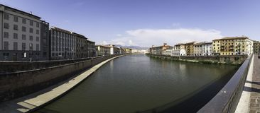 Panoramic view of the Arno river from Ponte Solferino, Pisa. Panoramic view of the Arno River from Ponte Solferino with its buildings painted in diverse and stock photography