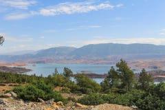 Panoramic view of the artificial lake of Bin el Oiudane. Bin El Ouidane, Azilal Province, Béni Mellal-Khénifra, Morocco - November 3, 2012 royalty free stock photo