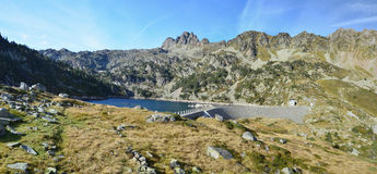 Panoramic view of the artificial lake in mountains Stock Photography