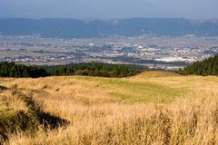 Panoramic view of Aso city inside Aso volcanic caldera, part of Aso-Kuju National Park stock image