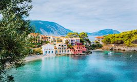 Panoramic view of Assos village in Kefalonia, Greece. Turquoise blue colored water in Mediterranean sea and beautiful. Cute colorful local houses royalty free stock images