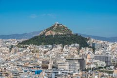 Panoramic view of Athens from Acropolis hill, sunny day. Lecabetus Hill also known as Lykabettos or Lykavittos royalty free stock images