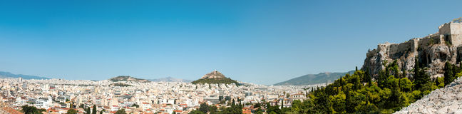 Panoramic view of Athens city in Greece. Panoramic view of the capital city of Athens in Greece with the famous Acropolis and Lykavitous hill Royalty Free Stock Image