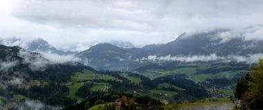 Panoramic view of Austrian mountains, peaks. Tirol resort in Austria, beautiful landscape, snow on mountains peaks. View through the clouds stock images