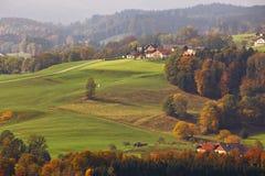 Beautiful mountain rural autumn landscape. Fantastic views of Au. Panoramic view of Austrian village on mountain hills in Alps. Beautiful mountain rural autumn Stock Photos