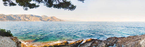 Panoramic view of azure sea coastline. Paloma beach, France Royalty Free Stock Photos