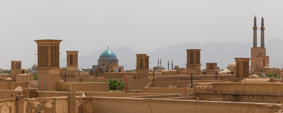 Panoramic view of badgirs and mosques of Yazd Stock Photos