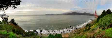 Panoramic view on Baker Beach and Pacific Ocean. Royalty Free Stock Images
