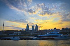Panoramic view of Baku - the capital of Azerbaijan located by the Caspian See shore. Sunset background. Flame Towers building is b. Panoramic view of Baku - the royalty free stock photo