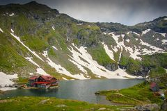 Panoramic view of Balea Lake. And cabin with Fagaras Mountains background Stock Photography