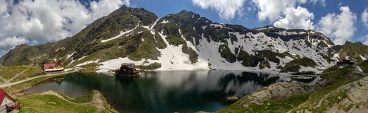 Panoramic view of Balea Lake, Romania. Balea Lake is a glacial lake in the Faragas Mountains at the Transfagaras highway pass royalty free stock image