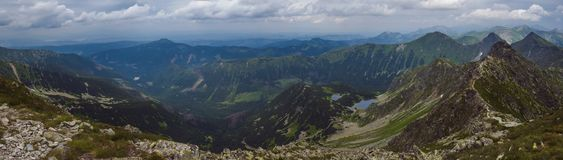 Panoramic view from Banikov peak on Western Tatra mountains or Rohace panorama. Sharp green mountains - ostry rohac. Placlive and volovec with hiking trail on royalty free stock photography