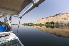 Panoramic view of the bank of the river Nile from a traditional feluca near Aswan, South Egypt. stock image