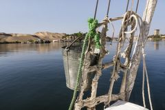 Panoramic view of the bank of the river Nile from a traditional feluca near Aswan, South Egypt. royalty free stock photography