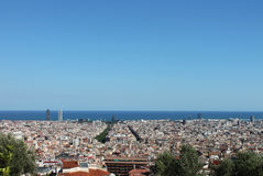 Panoramic view of Barcelona from Parc de Montjuic. View of the city, numerous houses and the sea Stock Photos
