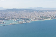 Panoramic view of Barcelona and port in Spain. You can see the Tibidabo mountain, Agbar tower, the Sagrada Familia and the Ramblas, among other emblematic Royalty Free Stock Image