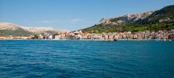 Panoramic view of Baska town and mountains from sea - Croatia Stock Photos