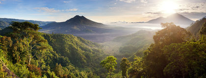 Panoramic view Batur volcano. Batur volcano and Agung mountain panoramic view at sunrise from Kintamani, Bali, Indonesia Stock Images