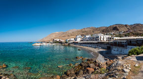Panoramic view on bay with small beach in centre of Chora Sfakion town, Crete, Greece Stock Images