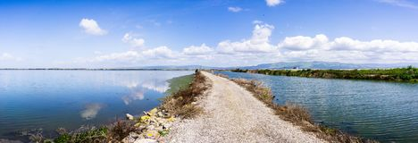Panoramic view of the bay trail and the wetlands near Sunnyvale, San Francisco bay area, California royalty free stock photography
