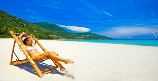 Panoramic view of the beach with an attractive woman sunbathing Stock Photography