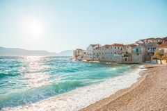 Panoramic view on a beach of a small town Postira - Croatia, island Brac. Panoramic view on a beach of beautiful town Postira - Croatia, Brac island Stock Photo