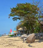 Beach Chairs & Sailing Boats on Sanur Beach, Bali Indonesia Royalty Free Stock Photos