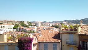 Panoramic view of beautiful architecture and historic houses downtown Cannes city. Panoramic view of beautiful architecture and historic houses downtown city of stock footage