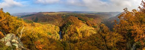 Panoramic view of beautiful autumnal landscape with river valley stock image