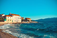 Panoramic view on a beautiful beach of a small Croatian town Postira - Croatia, island Brac. Panoramic view on a beautiful beach of small Croatian town Postira stock photo