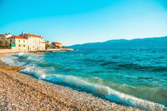 Panoramic view on a beautiful beach of a small town Postira - Croatia, island Brac. Panoramic view on a beautiful beach of town Postira - Croatia, Brac island royalty free stock image