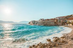 Panoramic view on a beautiful beach of a small town Postira - Croatia, island Brac. Panoramic view on a beautiful beach of town Postira - Croatia, Brac island stock photo
