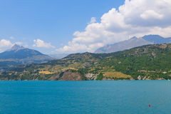 Panoramic view of the beautiful blue lago di Serre-Poncon in the Royalty Free Stock Photos