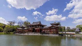 Panoramic view of the beautiful Byodo-in temple in Uji, Kyoto, Japan, on a beautiful sunny day with some clouds. Panoramic view of the beautiful Byodo-in temple stock images