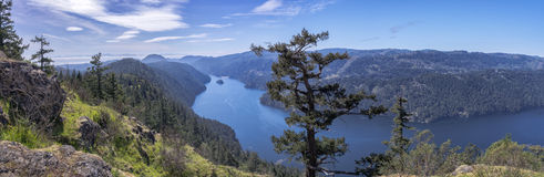 A panoramic view of a beautiful fiord, British Columbia, Canada. A hiking trail at Gowlland-Tod Provincial Park, Victoria, British Columbia, Canada stock photos