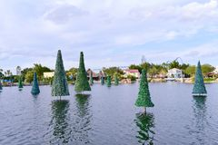 Panoramic view of beautiful lake with Christmas Trees on cloudy sky background at Seaworld The royalty free stock photo