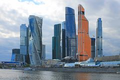 Panoramic view of the modern glass architectural complex Moscow city cloudy spring day Moscow Russia. Panoramic view of the beautiful modern glass architectural royalty free stock image