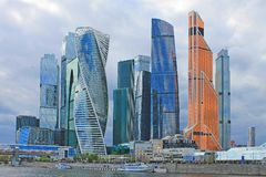 Panoramic view of the modern glass architectural complex Moscow city cloudy spring day Moscow Russia. Panoramic view of the beautiful modern glass architectural royalty free stock photo