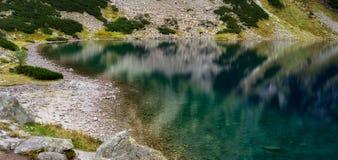 Panoramic view of beautiful mountain lake. Black Lake below Mount Rysy, Eastern Tatras, Poland royalty free stock image