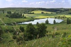 Panoramic view of beautiful mountain landscape Lake.  Royalty Free Stock Photo
