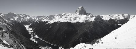 Panoramic view on beautiful mountain range in pyrenees with mountain peak pic du midi and lake in black and white, france stock illustration