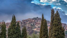 Panoramic view of a beautiful mountain village named Dimitsana u. Nder a dramatic sky and fog, Peloponesse, Greece Royalty Free Stock Images