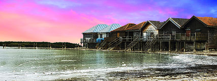 Panoramic view, Beautiful river, old wooden houses over colorful sky and clouds Stock Photo