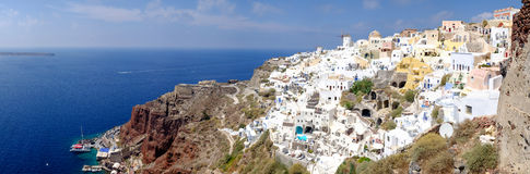 Panoramic view of beautiful romantic village Oia in Santorini Royalty Free Stock Photo