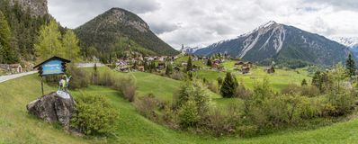 Panoramic view of beautiful Schmitten village in Graub�nden, Switzerland. Schmitten, Switzerland - May 2017 - Panoramic view of beautiful Schmitten village in Stock Photos