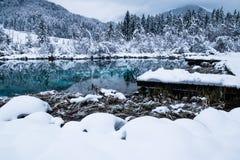 Beautiful winter scenery on pure lake Zelenci in cloudy sunrise, Kranjska Gora, Slovenia Royalty Free Stock Images