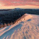 Panoramic view of beautiful winter wonderland mountain scenery in evening light at sunset. Mountains above the clouds. Christmas royalty free stock images